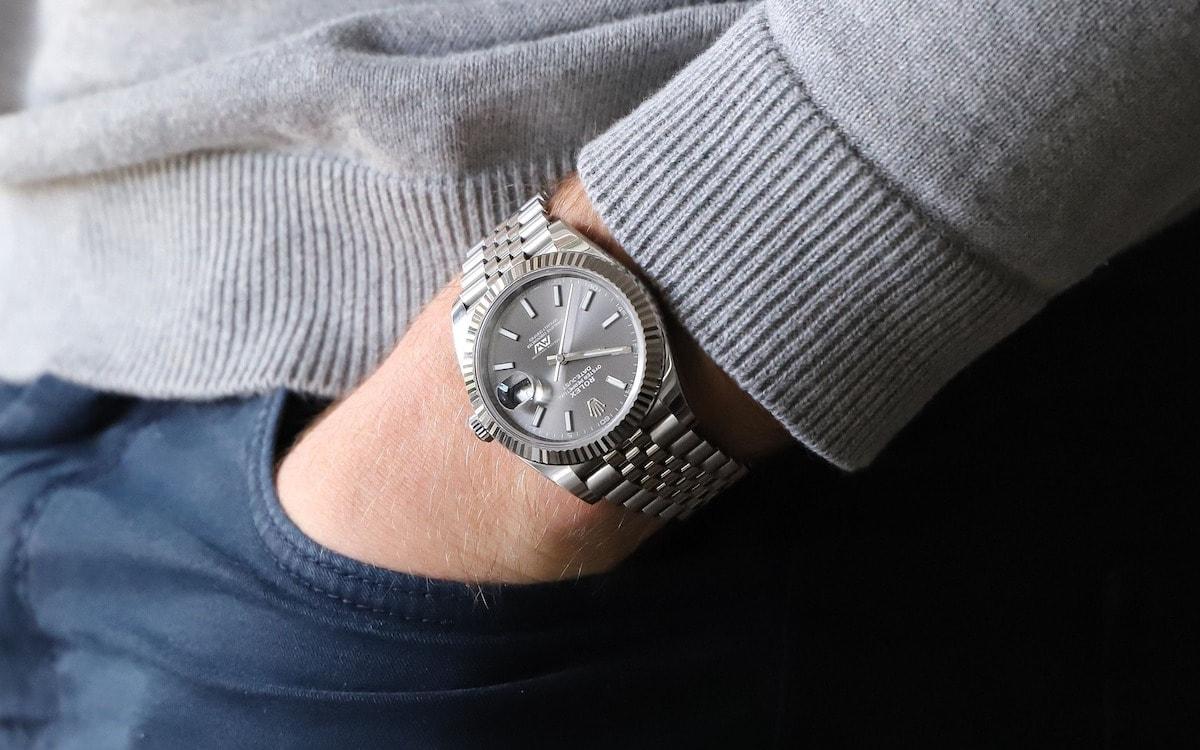 man wearing rolex watch