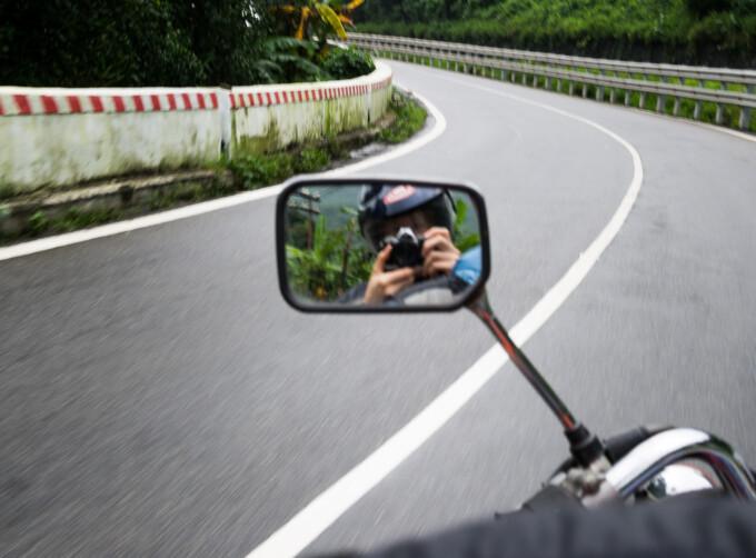 motorbike rearview mirror driving along the hai van pass