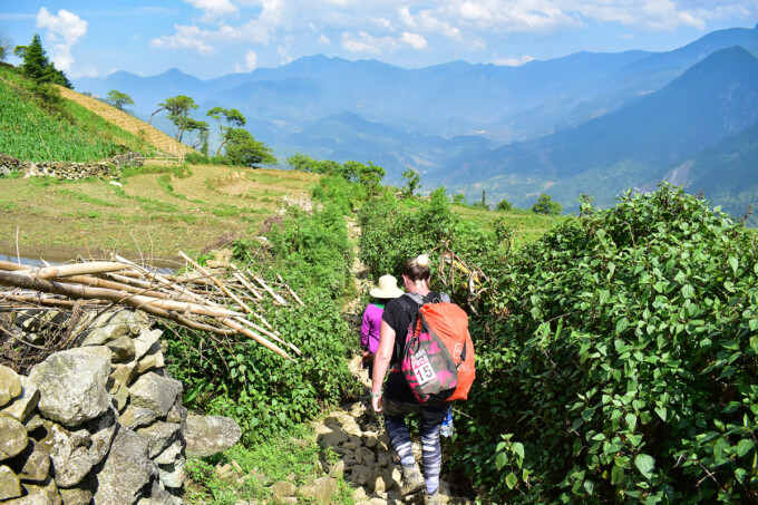 woman hiking in sapa with tour guide