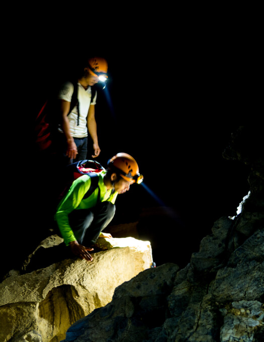 two vietnamese guides in the caves in phong nha