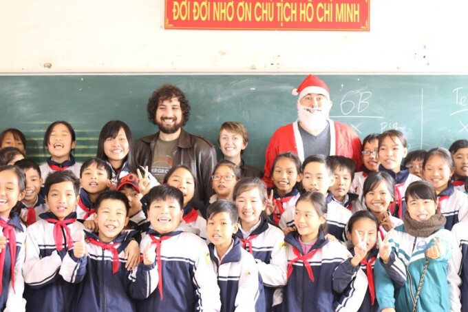 vietnamese students in a classroom with a santa claus
