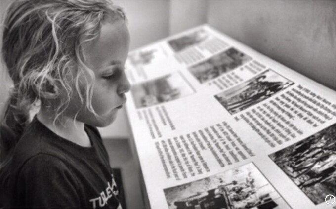 small girl viewing exhibits at the war remnants museum in saigon