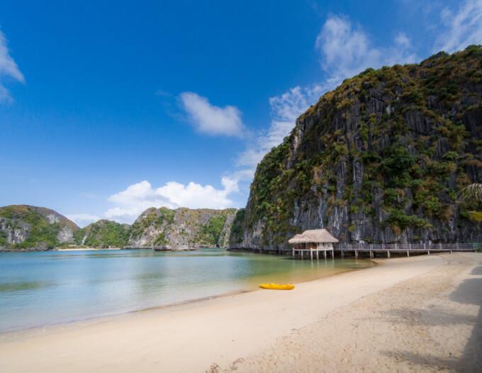 yelllow kayak on a white sand beach in la han bay