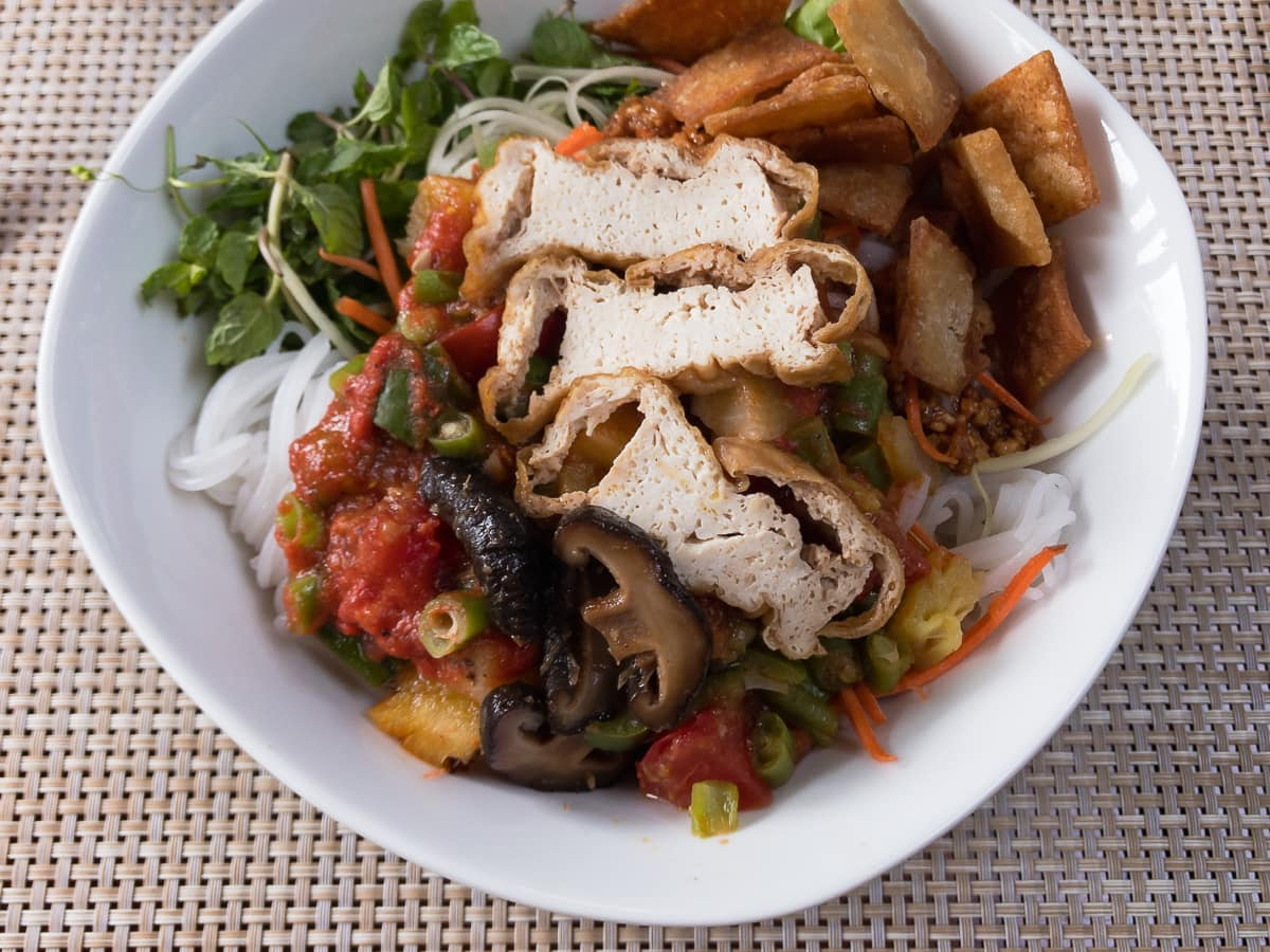 bowl of noodles with tofu and mushrooms
