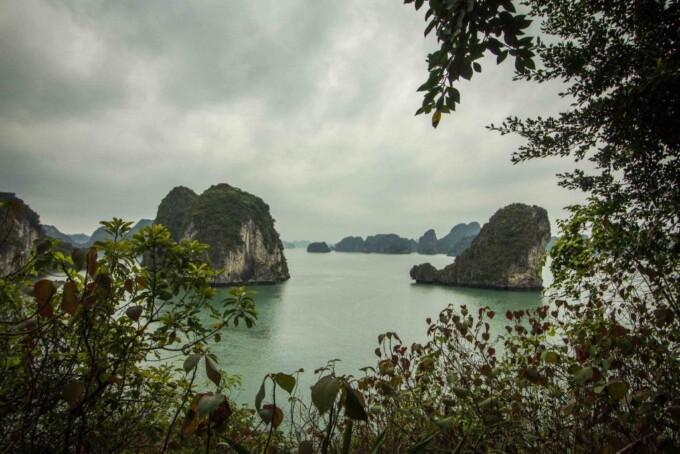 karst mountains rising out of bai tu long bay vietnam