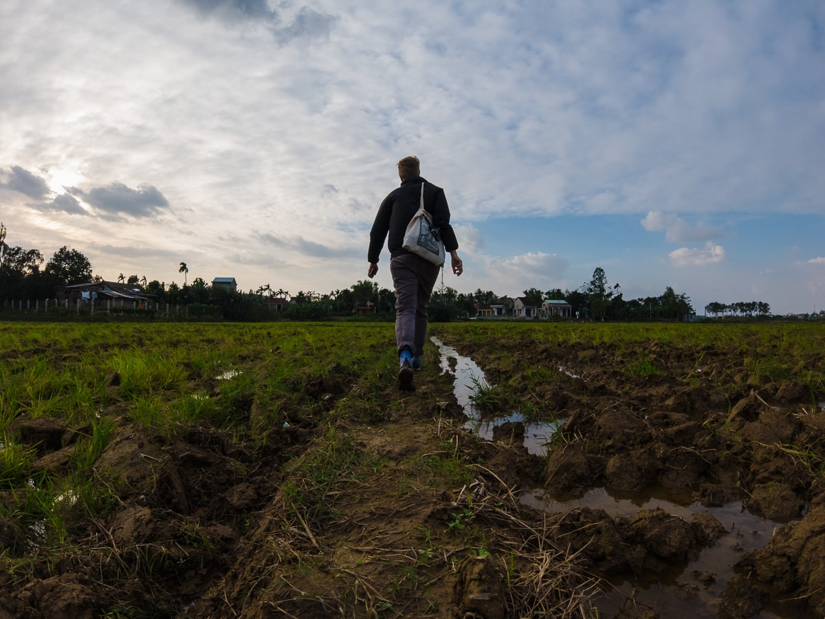 jane walking through fields in hoi an
