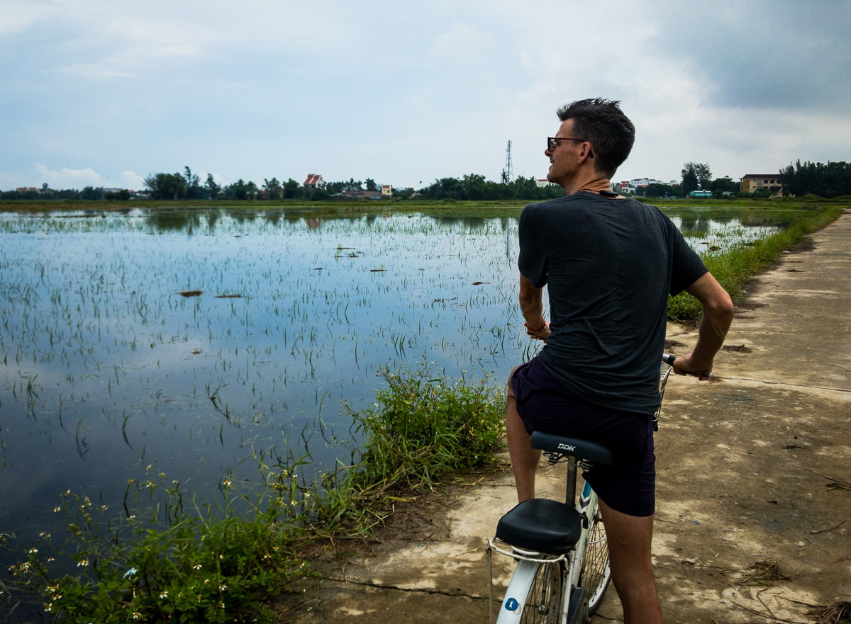 stephen on bicycle in rice fields