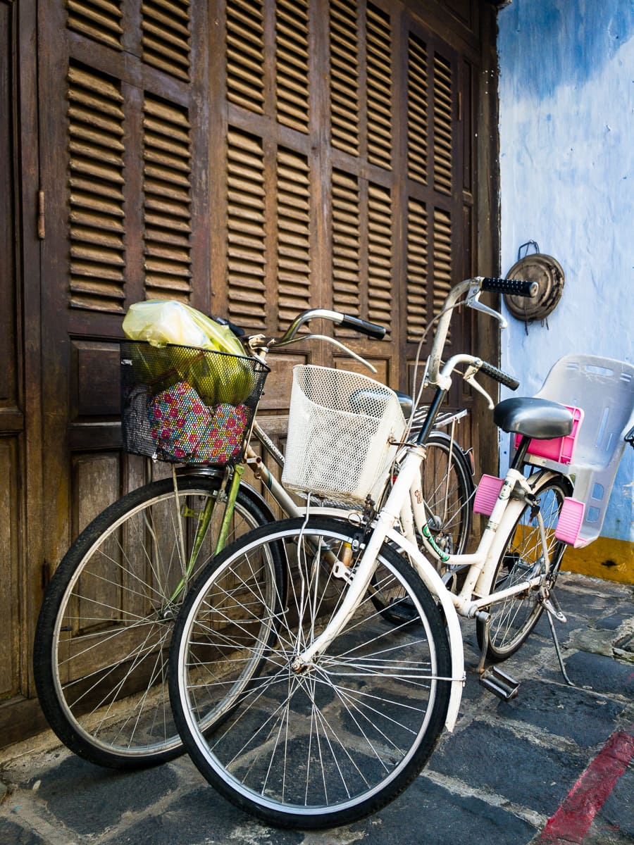 bicycles against a wooden shutter door