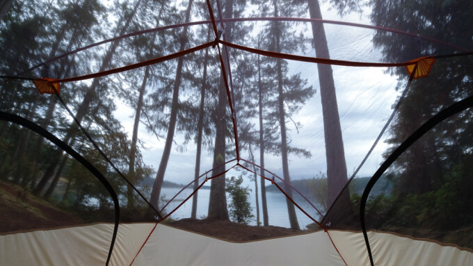 view from inside a tent overlooking the ocean