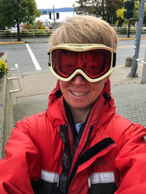 author dressed in foul weather gear on the sidewalk