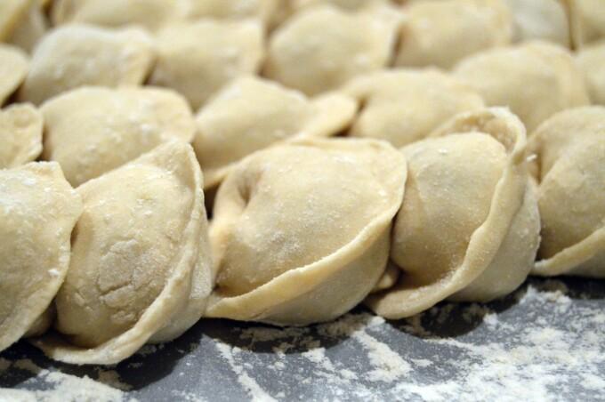 tray of uncooked dumplings