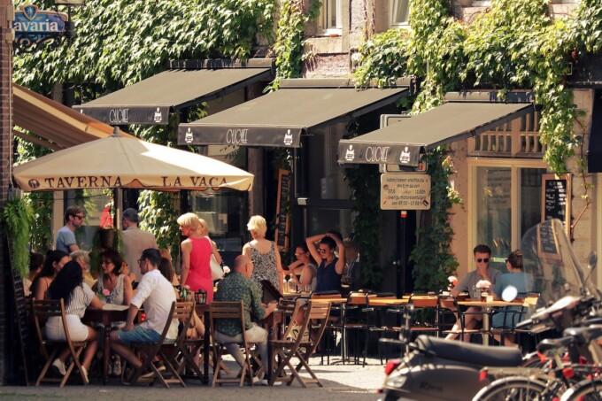 sidewalk cafe crowded with customers