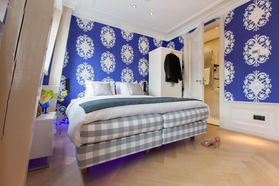 elegant but small amsterdam hotel room europe travel tips
