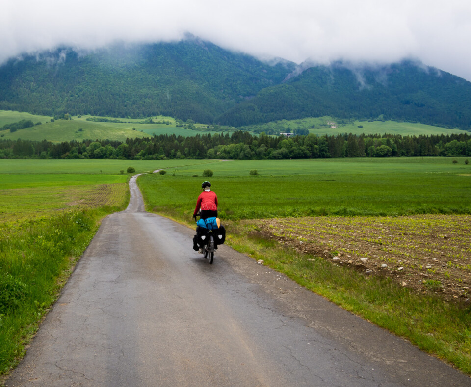 jane cycling up into the mountains in slovakia