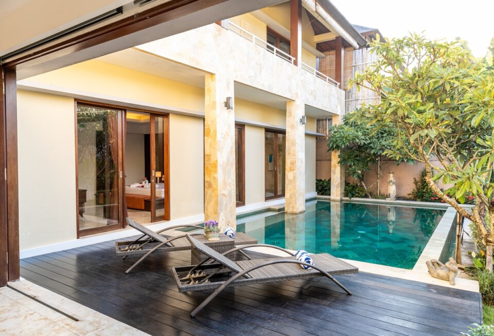 chairs beside the pool in a bali villa