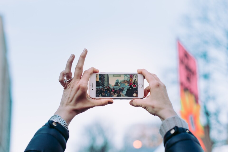 woman taking a photo with a smartphone