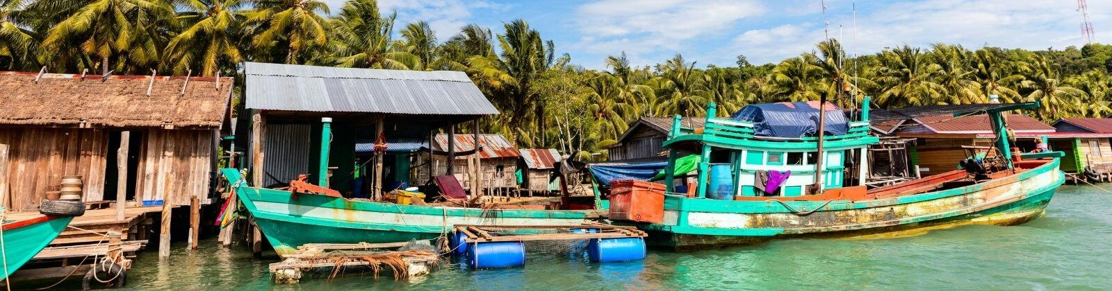 wooden boats in a cambodian floating village
