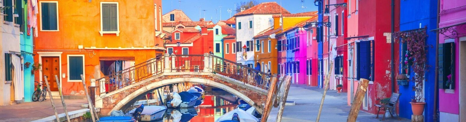 colorful houses on a canal in venice