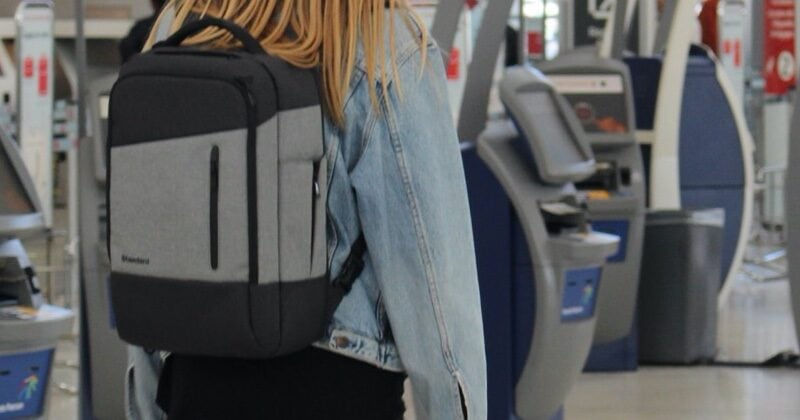 woman wearing anti theft backpack